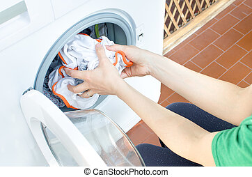 woman clothes washing machine chores