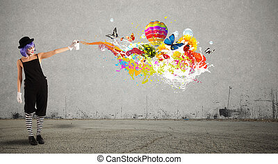 Woman clown with colored spray paints trails