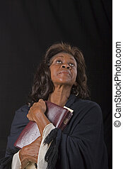 Woman Clutching Bible Looking Up - A spiritual black woman...