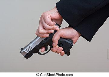 Woman cocking a hand gun