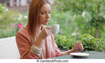 Woman coffee break - Woman at the cafe having a coffee...