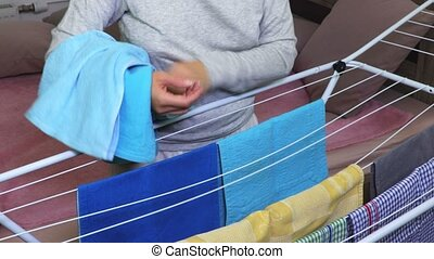 Woman collects blue dry towels