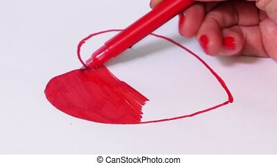 Woman coloring red heart shape