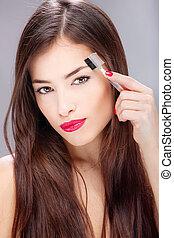 woman combing eyebrow
