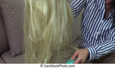 Woman combing wig close up