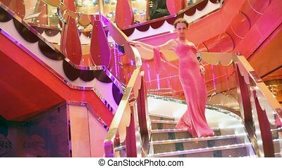 woman comes down the stairs - beautiful woman dressed in...