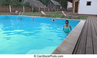 Woman comes out of the pool