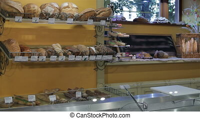 Woman comes to the counter at the pastry shop - Attractive...