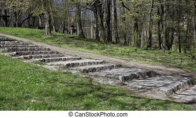 woman coming down the stone stairs