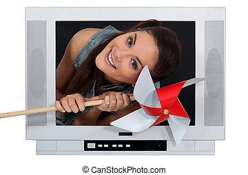 Woman coming out from TV with a grinder