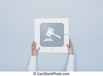 Woman completing a puzzle with a gavel icon