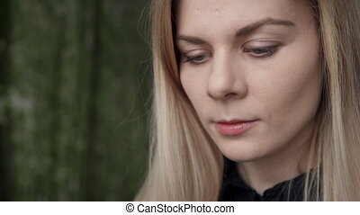 Woman concentrated view of considering reading information on phone