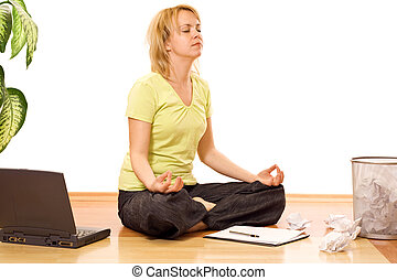 Woman in yoga pose meditating during a break from work - isolated