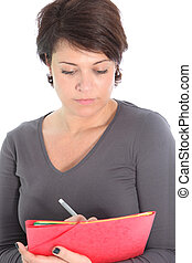 Woman concentrating writing notes