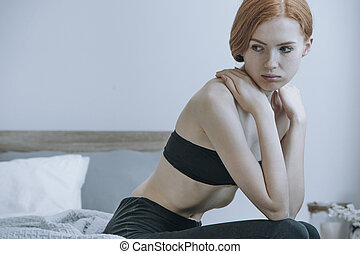 Woman concerned with her inappetence