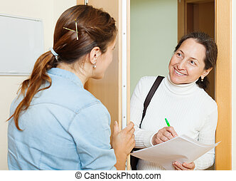 woman conducting a survey among residents - Mature woman...