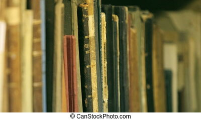 woman considering a book in the library, close-up, clip