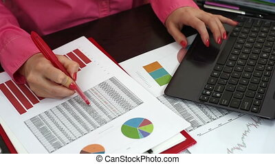report and scheme - woman considering financial report and...