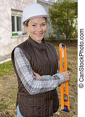 woman construction worker in hard hat taken outside