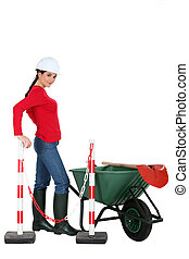 Woman construction worker with equipment