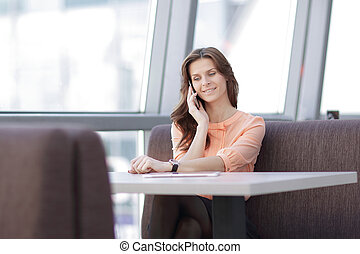 woman consultant with smartphone sitting at her Desk in the office