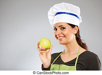 Woman cook holding an apple