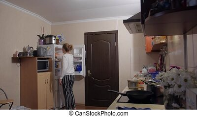 Woman cooking at home evening kitchen interior