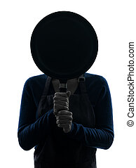 woman cooking hiding behind frying pan silhouette