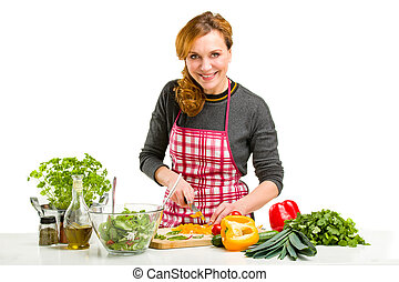 Woman Cooking in the kitchen. - Young Woman Cooking in the...