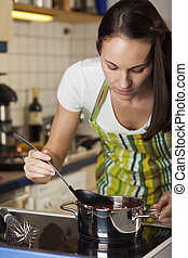 woman cooking in the kitchen