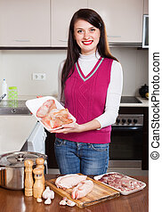 woman  cooking jellied meat with  offals