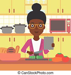 Woman cooking meal. - An african-american woman holding a...