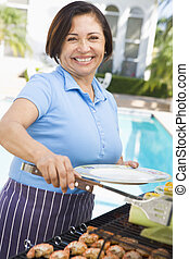 Woman Cooking On A Barbeque