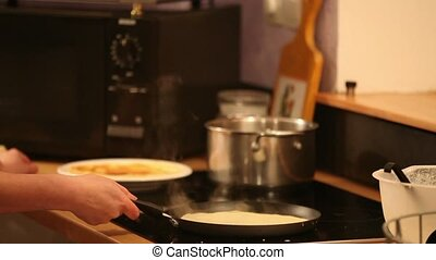 woman cooking pancakes