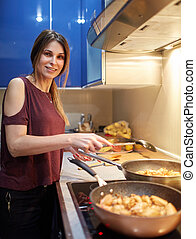 Woman cooking thai recipes at home