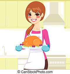 Woman Cooking Thanksgiving Turkey - Beautiful young woman...