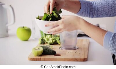 woman cooking vegetable solid baby food at home - culinary,...