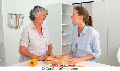 Woman cooking with her mother