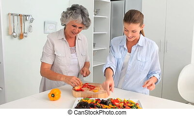 Woman cooking with her mum