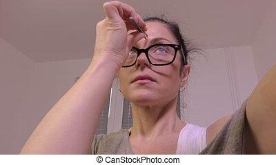 Woman correcting eyebrows
