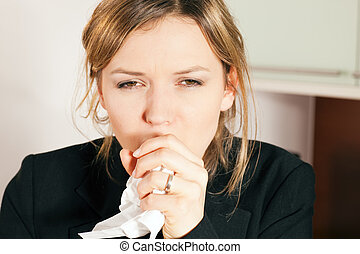 Woman coughing - Woman having a cold, coughing, holding a...