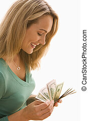 Woman Counting Cash - An attractive young woman is counting ...