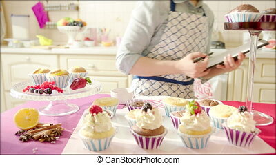 Woman counting cup-cakes - Shot of woman out-of-focus...