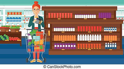 Woman counting on calculator. - A woman standing near...