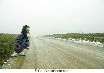 woman, country road in fog
