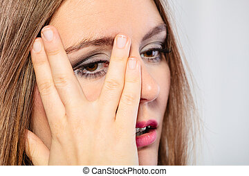 Woman cover face look through fingers. - Face expressions...