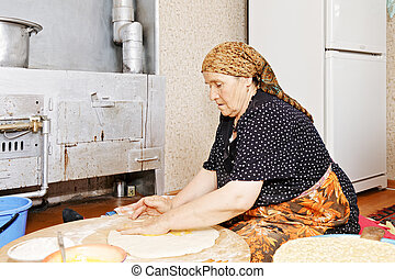 Woman covering bread with ghee