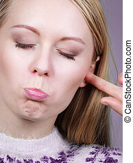 Woman covering ears with fingers