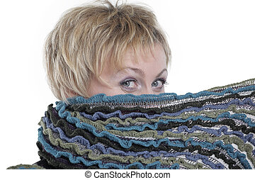 Woman covering her face with a scarf isolated on white background