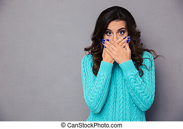 Woman covering her mouth - Portrait of a young woman ...